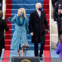 U.S. President-elect Joe Biden flanked by wife Dr. Jill Biden arrives for his inauguration as the 46th U.S. president on Wednesday at the U.S. Capitol in Washington. | AFP-JIJI