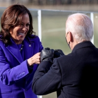 Kamala Harris bumps fists with Joe Biden after being sworn in as vice president of the United States during the inauguration on the West Front of the U.S. Capitol in Washington on Wednesday. | REUTERS