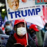 Supporters of U.S. President Donald Trump protest ahead of the inauguration of President-elect Joe Biden, in Tokyo's Ginza district on Wednesday.  | REUTERS
