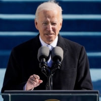 Joe Biden delivers a speech after being sworn in as the 46th president of the United States in Washington on Wednesday.  | POOL / VIA AFP-JIJI