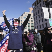 Supporters of Joe Biden celebrate after his inauguration speech in Washington. | GETTY IMAGES / VIA KYODO