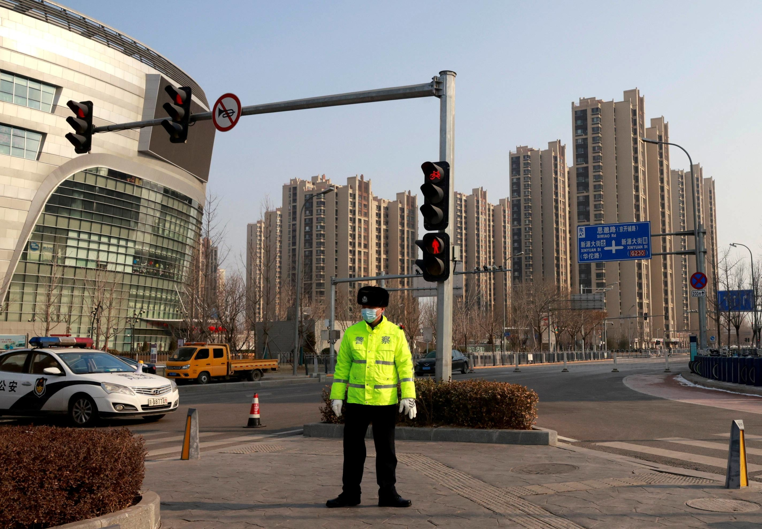 Police guard a blocked-off street in the Tiangongyuan area of Beijing's Daxing district on Wednesday following new cases of COVID-19.  | REUTERS