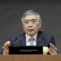 The Bank of Japan forecasts the economy will shrink 5.6% in the fiscal year through March, compared with its October forecast for a 5.5% contraction, but grow 3.9% in fiscal 2021, up from an earlier forecast of 3.6%. | BLOOMBERG
