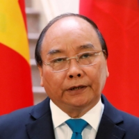 Vietnam's Prime Minister Nguyen Xuan Phuc holds a news conference in May 2019.  | REUTERS
