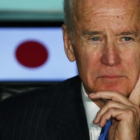 Then-U.S. Vice President Joe Biden meets with Japanese business leaders at the headquarters of internet commerce and mobile games provider DeNA Co. in Tokyo in December 2013. | REUTERS