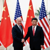 Chinese President Xi Jinping greets then-Vice President Joe Biden in Beijing in December 2013. | REUTERS