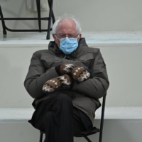 Sen. Bernie Sanders sits in the bleachers on Capitol Hill before Joe Biden is sworn in as the  U.S. president on Wednesday.