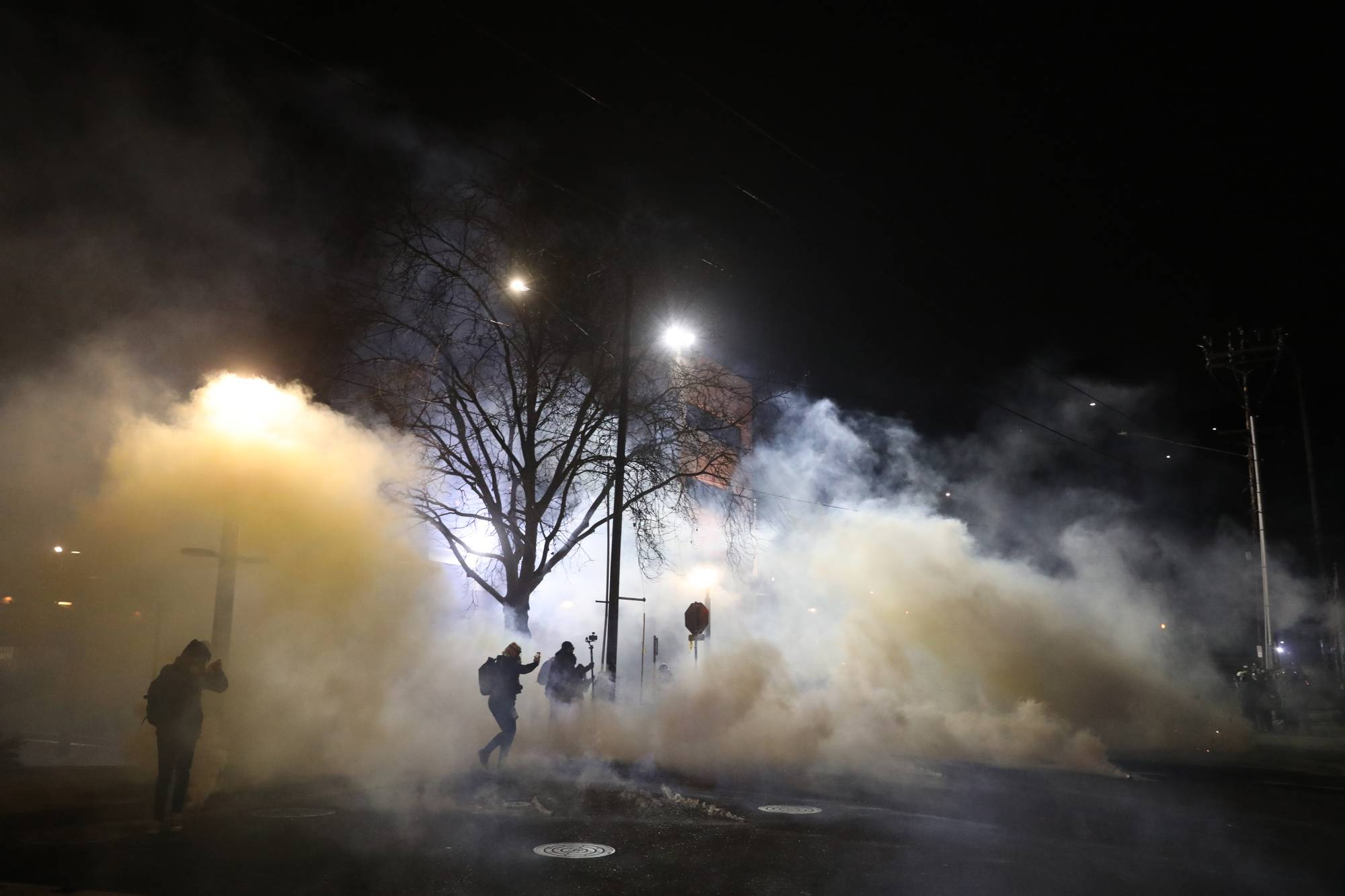 Law enforcement deploy tear gas Wednesday at a protest outside an Immigration and Customs Enforcement building in Portland, Oregon, on Wednesday. | ALISHA JUCEVIC / THE NEW YORK TIMES