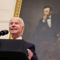 With a portrait of former President Abraham Lincoln hanging in the background, U.S. President Joe Biden speaks about his administration's plans to fight the coronavirus, at the White House on Thursday.  | REUTERS