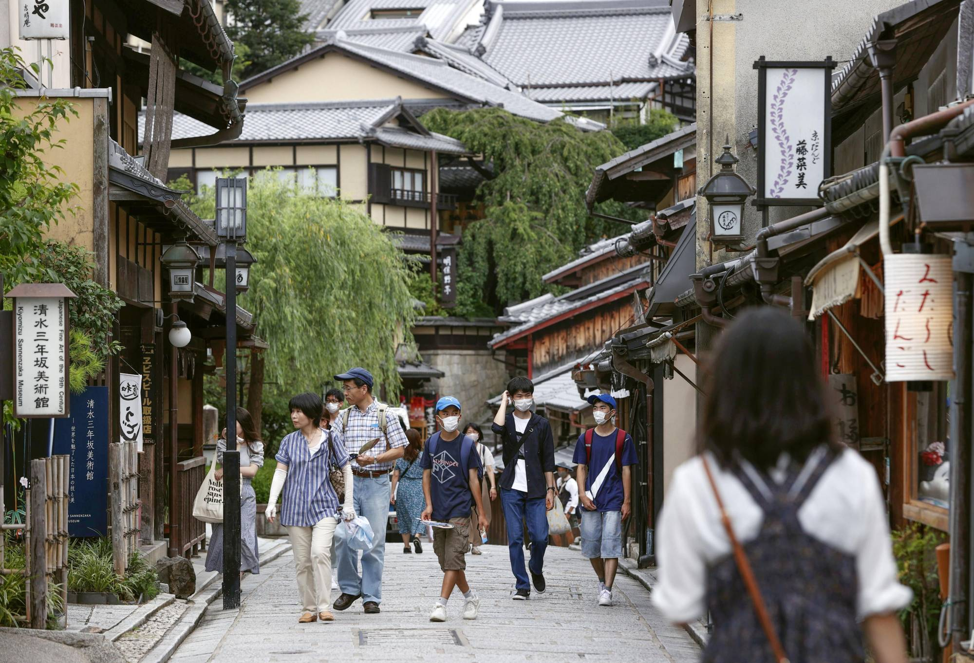 People walk near Kiyomizu Temple in Kyoto in July as the government's Go To Travel campaign kicked off, excluding trips to and from Tokyo. | KYODO