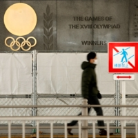 The Olympic rings are displayed outside Tokyo's National Stadium on Jan. 8. Experts are split over whether the Summer Games should require the vaccination of participating athletes. | REUTERS