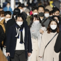 Japan retains economic view in January despite virus emergency