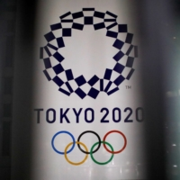 Holding the Tokyo Olympics and Paralympics without spectators would result in an economic loss of up to ¥2.4 trillion in Japan, a new estimate says. | REUTERS