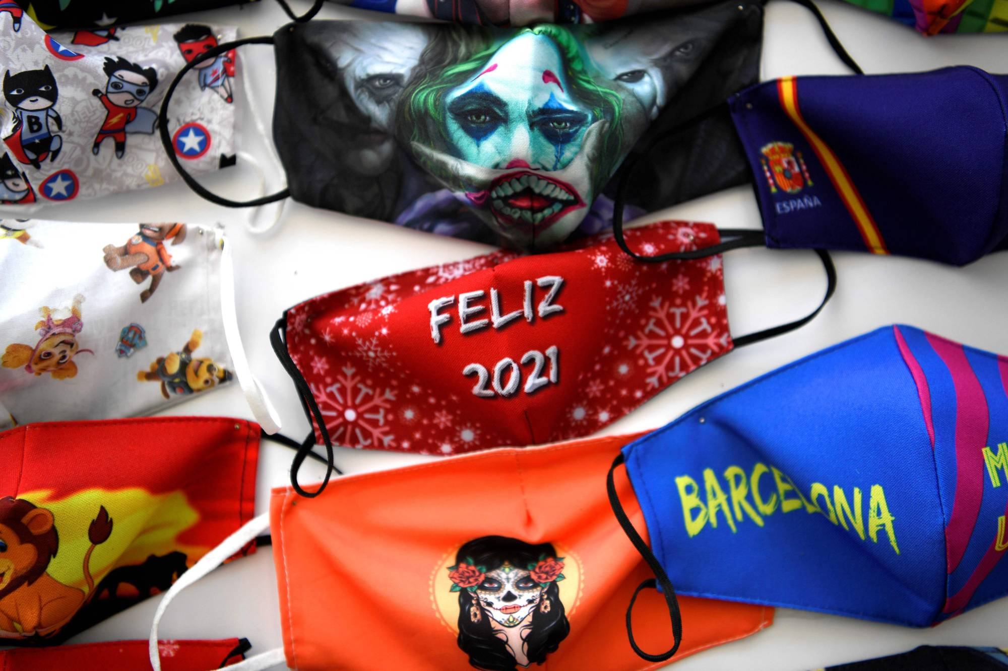 Fabric face masks are displayed for sale at a store in Madrid on Friday. | AFP-JIJI