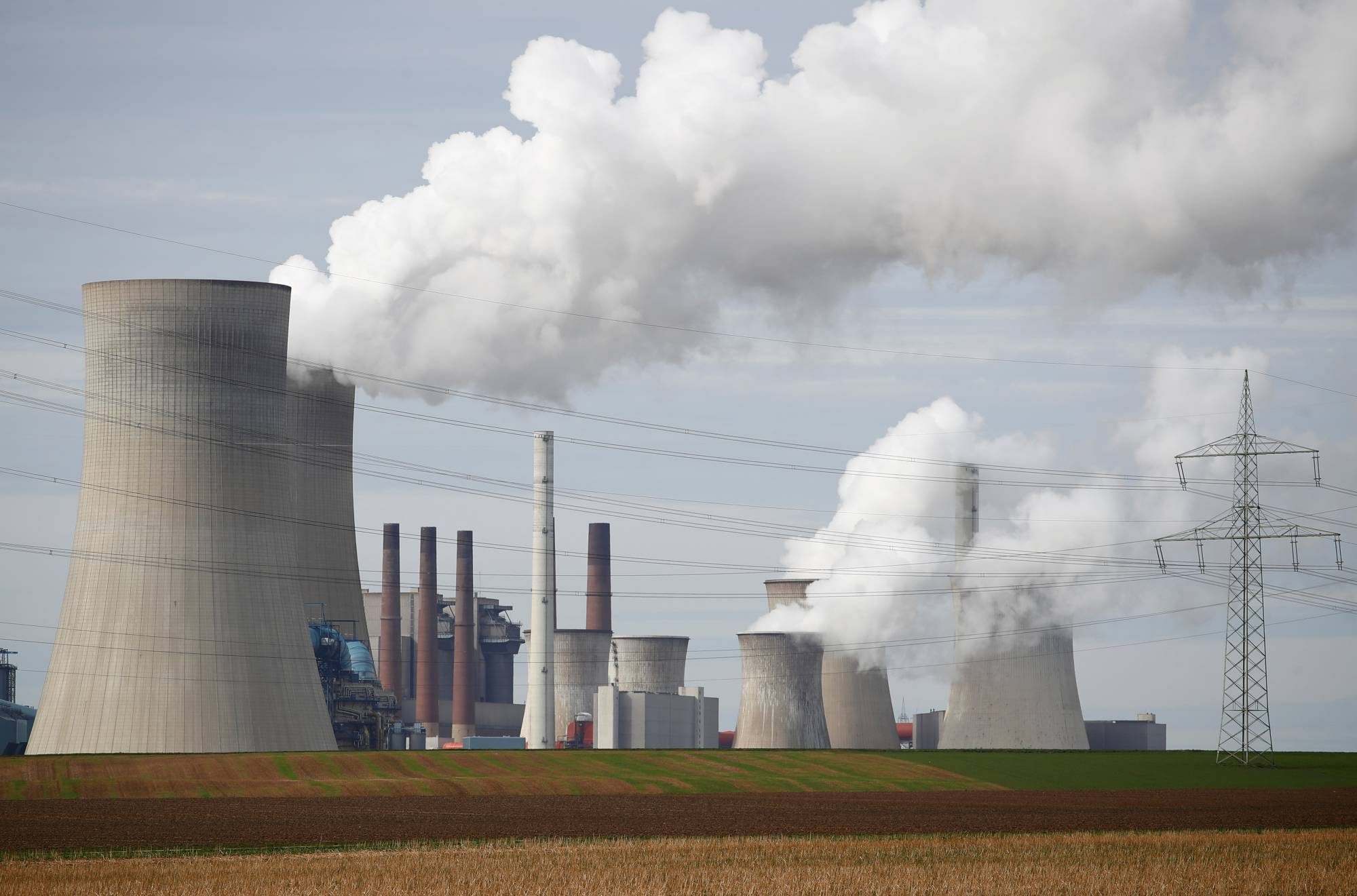 Steam rises from the five brown coal-fired power units of RWE, one of Europe's biggest electricity companies in Neurath, Germany, in March 2019. | REUTERS