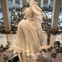 National Guard members rest in the Capitol Visitors Center on Capitol Hill in Washington on Jan. 13. | AFP-JIJI
