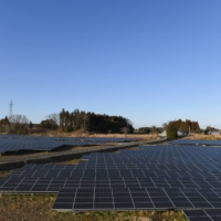 Solar panels installed by Fukushima Electric Power Co. in Tomioka, Fukushima Prefecture | BLOOMBERG