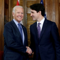 Canadian Prime Minister Justin Trudeau shakes hands with then-U.S. Vice President Joe Biden during a meeting in Trudeau's office on Parliament Hill in Ottawa in December 2016. | REUTERS