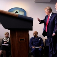 During a briefing in April last year, U.S. President Donald Trump directs White House coronavirus task force members, including CDC Director Robert Redfield (right).  | REUTERS