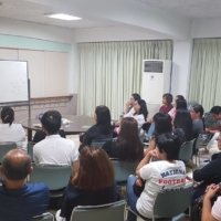 Holy gathering: Father Edwin Corros, a missionary priest assigned to work with the Catholic Tokyo International Center, teaches catechism to Filipino parishioners at Meguro Catholic Church in September 2019.  | EDWIN CORROS / KYODO