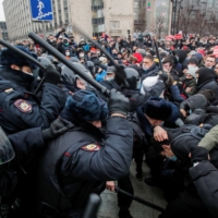 Law enforcement officers clash with participants during a rally in support of jailed Russian opposition leader Alexei Navalny in Moscow on Saturday. | REUTERS