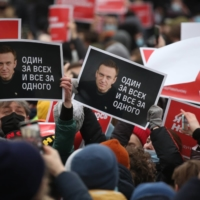 Supporters hold placards depicting Russian opposition leader Alexey Navalny during a demonstration in Moscow on Saturday. | BLOOMBERG