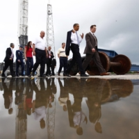 Then-U.S. President Barack Obama tours a launch pad with SpaceX CEO Elon Musk at Cape Canaveral Air Force Station in Florida in April 2010. | LUKE SHARRETT / THE NEW YORK TIMES