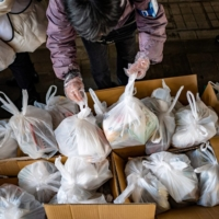 Nonprofit organization Moyai Support Centre for Independent Living has been giving out food packs to people in need in the Shinjuku district of Tokyo. | AFP-JIJI