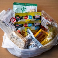 Food packs put together by Moyai Support Centre for Independent Living are being distributed by volunteers to people in need in parts of Tokyo. | AFP-JIJI