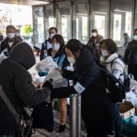 While Japan has seen a comparatively small coronavirus outbreak and avoided the harsh lockdowns seen in other countries, poverty campaigners say the most vulnerable are being hit hard. | AFP-JIJI