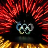 The Olympic rings are lit up at Tokyo's Odaiba waterfront on Sunday.