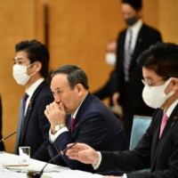 Suga faces mounting pressure over slow pandemic response