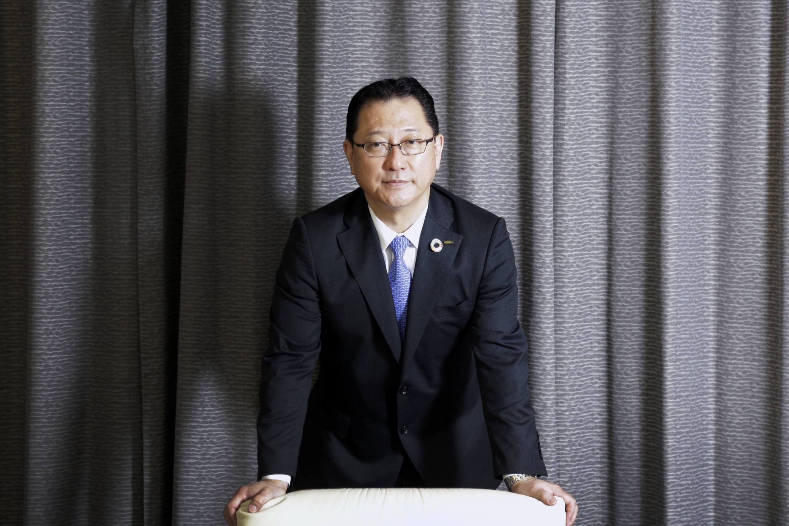 Jun Seki, president and chief operating officer of Nidec Corp., says the company has attracted 15 new inquiries about its EV motors. | BLOOMBERG