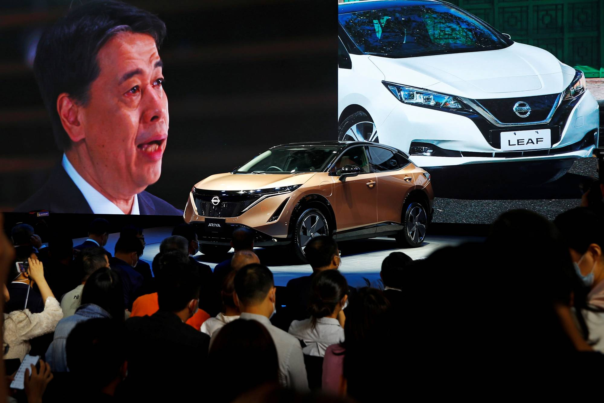 Nissan Chief Executive Officer Makoto Uchida speaks at a Nissan booth via video link during the presentation of the Ariya at the Beijing International Automotive Exhibition in Beijing in September 2020. | REUTERS