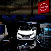 Nissan's electric vehicle Leaf is displayed at the Nissan's booth at the Beijing International Automotive Exhibition in Beijing in September 2020. | REUTERS