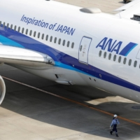 All Nippon Airways will halve its international flight services in fiscal 2021. | REUTERS