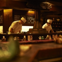 Chefs prepare deep-fried skewers of meat, seafood and seasonal vegetables at Ginza Isomura, a restaurant in Tokyo's upscale Ginza neighborhood. | COURTESY OF GINZA ISOMURA