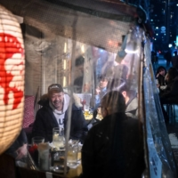 People dine at a restaurant in Tokyo on Friday. | AFP-JIJI