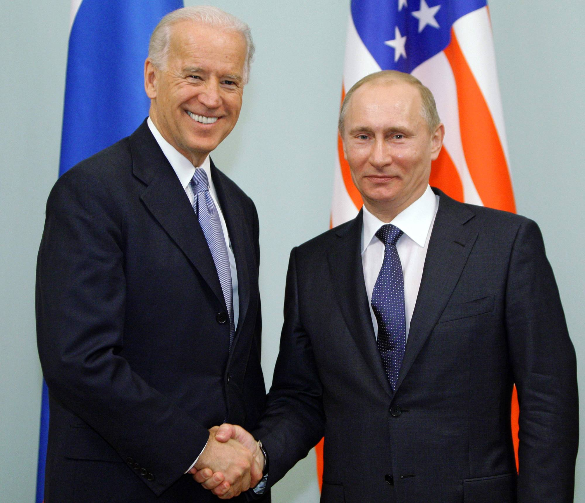 U.S. President Joe Biden and President Vladimir Putin of Russia, pictured in 2011, formally agreed to extend the last remaining nuclear arms treaty between their countries on Tuesday. | POOL / VIA AFP-JIJI