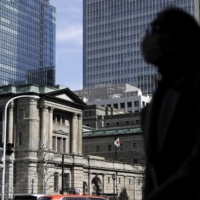 The Bank of Japan was the largest domestic entity to purchase local equities last year, with an expert saying the market is becoming more resilient to foreign outflows. | BLOOMBERG
