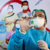 A medic shows a vial of AstraZeneca's COVISHIELD coronavirus vaccine in Yangon, Myanmar, on Wednesday after the country received 1.5 million doses of the drug manufactured by the Serum Institute of India. |  REUTERS