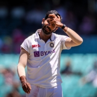 India's Jasprit Bumrah reacts after the catch of Australia captain Tim Paine was dropped on the first day of the third test against Australia In Sydney on Jan 10. | AFP-JIJI