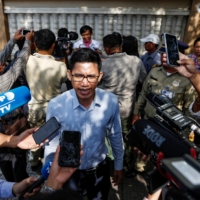 Yeang Sothearin and Uon Chhin, former journalists with U.S.-funded Radio Free Asia, speak to the media in front of the Municipal Court of Phnom Penh, in Cambodia, in October 2019 after being tried on charges of espionage. |  REUTERS