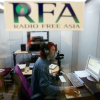 Chinese labour activist and Radio Free Asia broadcaster Han Dongfang speaks on a radio show from his studio in Hong Kong in 2004. Han mounted a daring protest during the ill-fated Tiananmen Square democracy movement in 1989, helping form a short-lived free trade union, and is among a handful of dissidents who continue to put pressure on Beijing over human rights. | REUTERS