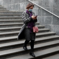 A woman uses her smartphone while walking into an underpass in Kyiv, Ukraine, in October last year. European lawmakers voted last week for the creation of new legal rights for employees to switch off from work-related tasks and electronic communication outside of office hours without facing consequences. | REUTERS