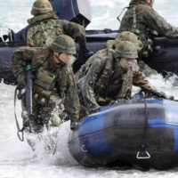 GSDF troops conduct an amphibious drill with the U.S. Marines at the Blue Beach training area in Kin, Okinawa Prefecture, in February 2020. | KYODO