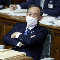 Prime Minister Yoshihide Suga is having a hard time getting his message across to younger people. | BLOOMBERG