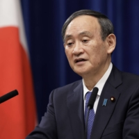 Prime Minister Yoshihide Suga's government is against the idea of inviting Australia, India and South Korea to a meeting of Group of Seven foreign ministers in the U.K. this summer, according to a diplomatic cable. | BLOOMBERG