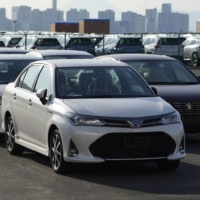 Toyota Motor Corp. vehicles await shipment at Yokohama port in October. Toyota overtook Volkswagen AG in 2020 to become the world's top-selling automaker. | BLOOMBERG