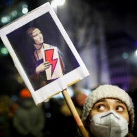 A demonstrator holds a placard during a protest against a verdict restricting abortion rights, in Warsaw on Thursday. | REUTERS